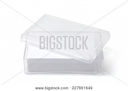 Open Transparent Plastic Box Holder With Blank Visit Cards On White.