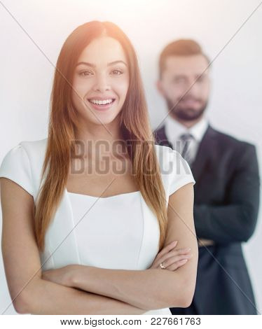 portrait of a business woman while the man is in the background