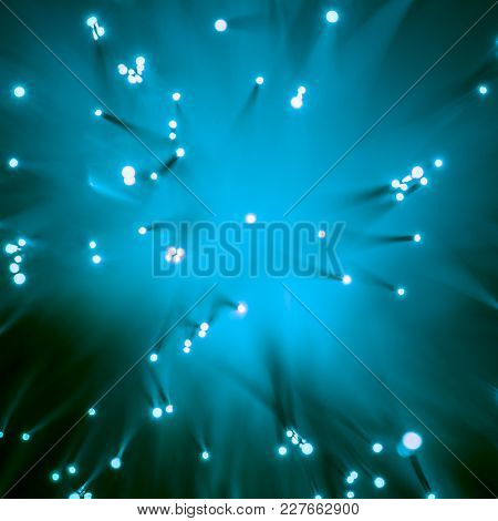 Top View Of Blurred Glowing Blue Fiber Optics Background