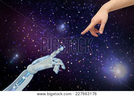 future technology and artificial intelligence concept - close up of human and robot hands over space background