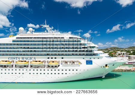St Johns, Antigua - March 05, 2016: Cruise Ship Costa Magica Docked In Sea Port. Vacation, Travel, W