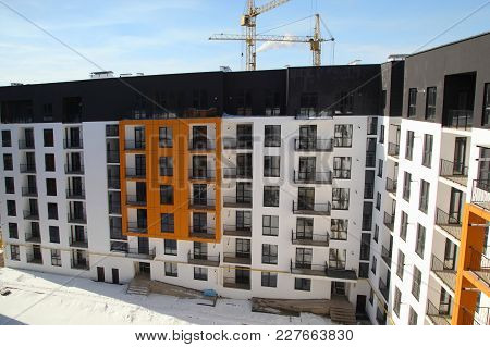 Construction Of A Residential Multi-storey Building. New Residential Area. Building -  Stock Image.