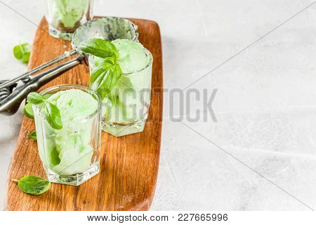Summer Desserts. Vegan Food. Basil Ice Cream In Serving Glasses, Decorated With Fresh Basil Leaves.