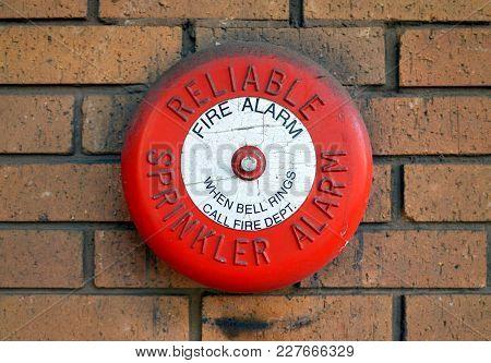 Bracknell, England - February 21, 2018: A Reliable Sprinkler Alarm Fire Alarm Bell On An External Br