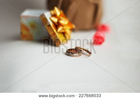 Wedding Rings On A White Background, Yellow Box