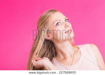Beautiful Blonde Girl Portrait With Hands For Cosmetic Concept Over Pink Background