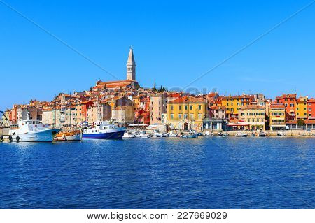 Beautiful And Cozy Medieval Town Of Rovinj, Colorful With Houses And Church The Harbor In Croatia, E