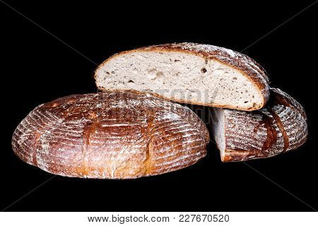 Traditional Round Sourdough Bread Isolated On Black.