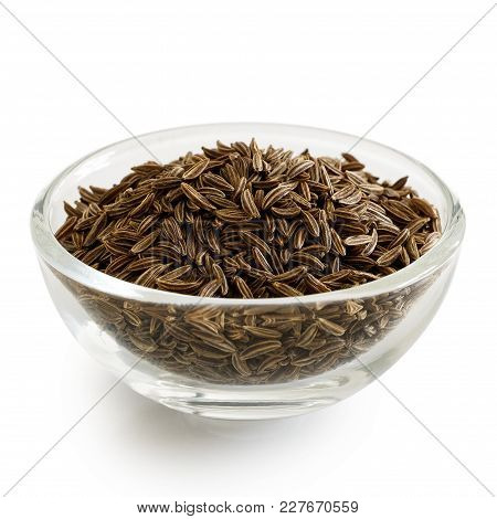 Caraway Or Cumin Seeds In Glass Bowl Isolated On White.