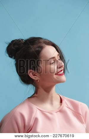 Happy Business Woman Standing, Smiling Isolated On Trendy Blue Studio Background. Beautiful Female P