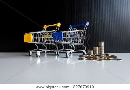 Mini Shopping Cart With Step Of Coins Stacks,finance And Money Shopping Concept