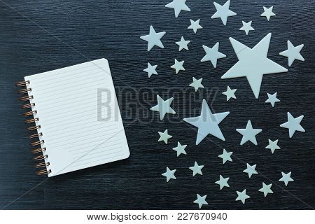 Decorative Stars Small And Large Lie On A Black Wooden Table. Stars Decoration.