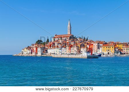 Beautiful And Cozy Medieval Town Of Rovinj, Colorful With Houses And Church The Harbor