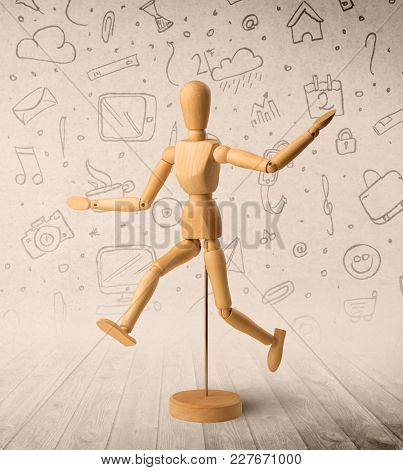Wooden mannequin posed in front of a greyish background with mixed media scribbles behind it
