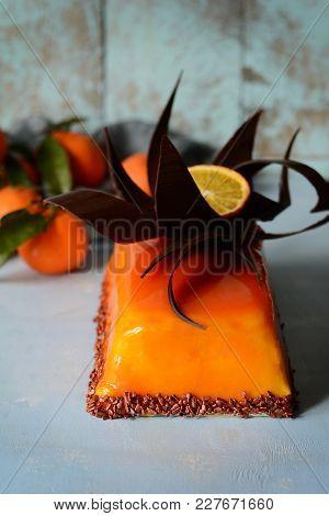 Mousse Cake With Vanilla Cream And Orange Mirror Glaze. Chocolate Decor. Gourmet Delicate Dessert. F