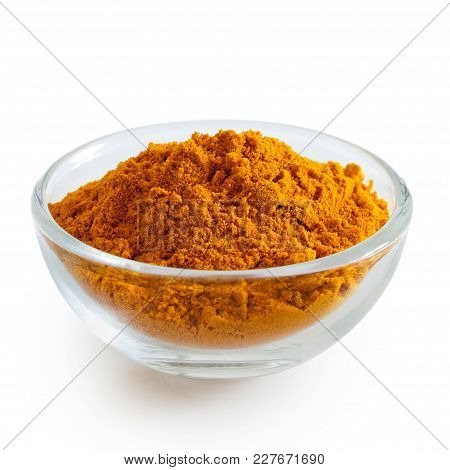 Turmeric Powder In Glass Bowl Isolated On White.