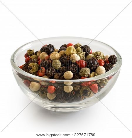 Mixed Peppercorns In Glass Bowl Isolated On White.