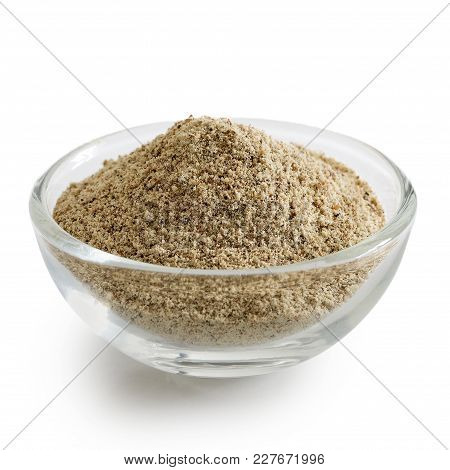 Finely Ground White Pepper In Glass Bowl Isolated On White.