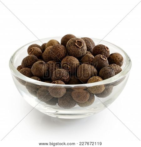 Whole Allspice In Glass Bowl Isolated On White.