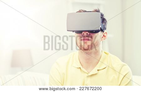 technology, gaming, entertainment and people concept - young man with virtual reality headset or 3d glasses playing video game