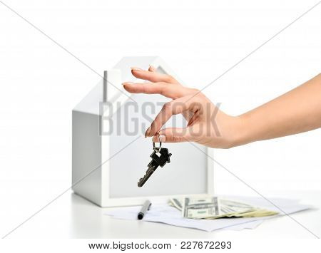 Property Investment Concept. Woman Hand Hold Key From New House Symbol Of Real Estate Money Investme