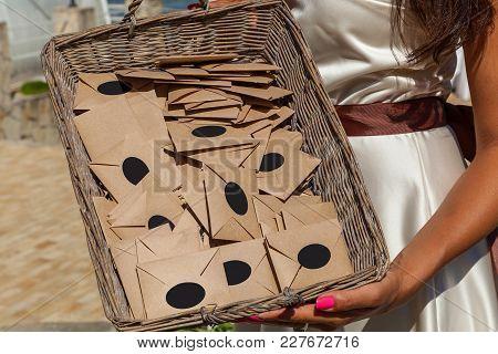 Girl Holding A Basket With Envelopes. Basket With Envelopes