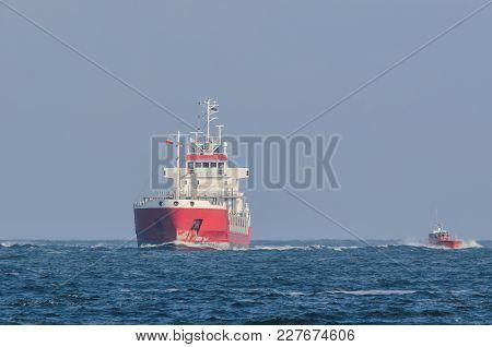 Merchant Vessel - Cargo Ships And Pilot Vessel At Sea