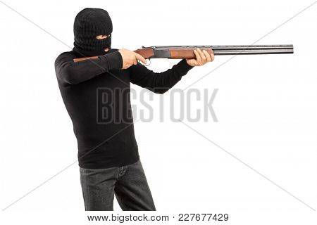 Masked man aiming with a rifle isolated on white background
