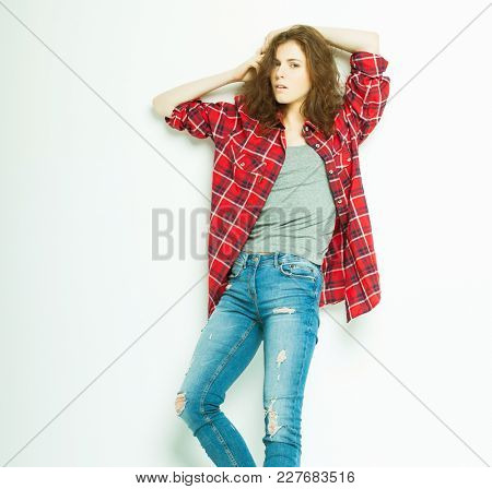 Full length casual fashion woman  posing over white background, studio shoot