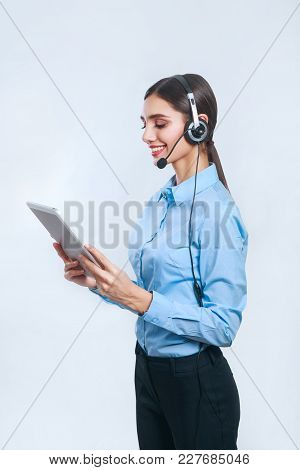 Female Customer Support Operator With Tablet. Call Center Operator