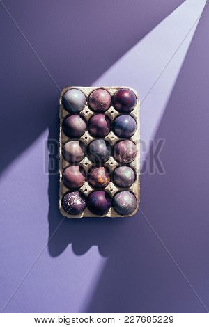 Easter Purple Eggs In Big Tray On Purple Background With Sunbeam