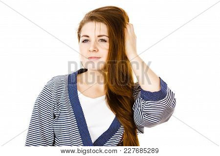 Feminine Beauty Concept. Portrait Of Beautiful Young Woman With Long Brown Hair Wearing Dressing Gow