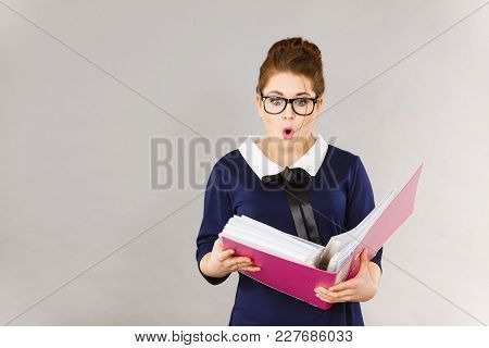 Shocked Accountant Business Woman Looking At Documents In Binder Seeing Something Surprising
