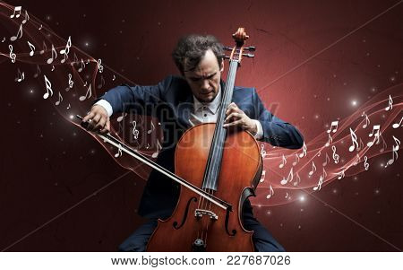 Lonely musical composer with cello and sparkling musical notes around