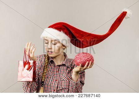 Xmas, Seasonal Christmas, Smart Clever Shopping Concept. Happy Woman Wearing Windblown Santa Claus H