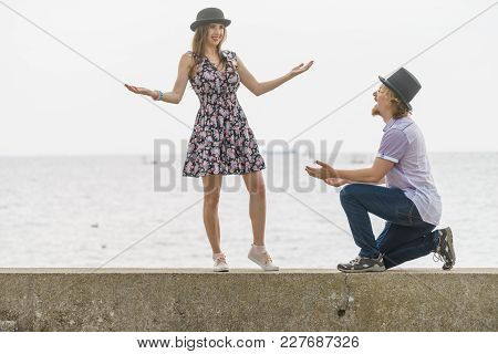Vintage Funny Retro Couple, Man And Woman Enjoying Their Romantic Date Outside Wearing Fedora Hats B