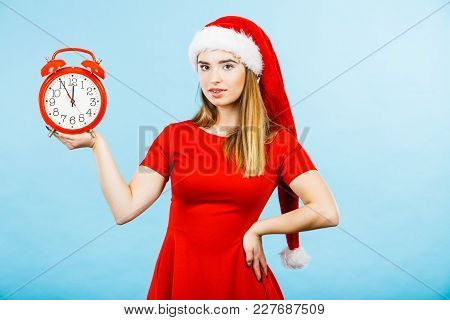 Xmas, Seasonal Clothing, Christmas Time Concept. Woman Wearing Santa Claus Helper Costume Holding Bi