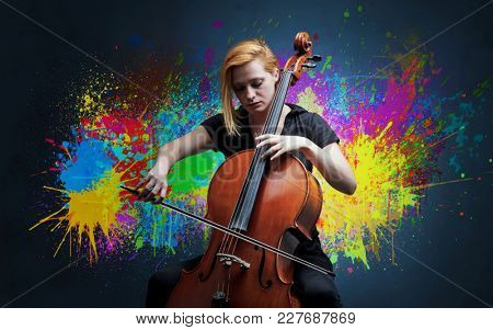 Young classical musician with colorful splotch wallpaper