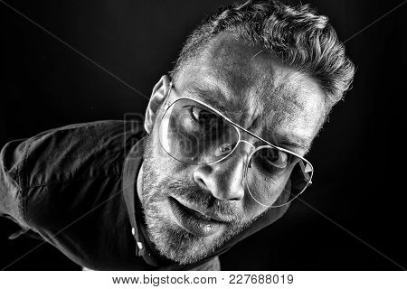 Bachelor In Glasses Look With Curious Face On Dark Background. Fashion, Style, Accessory. Beauty, Ba
