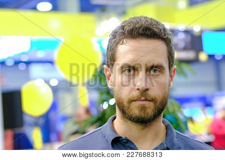 Man With Beard On Serious Face Pose On Blurred Colorful Background. Beauty, Fashion, Barber Concept.