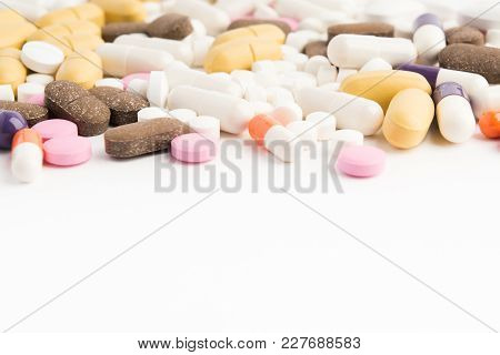 Pharmacy Tablets Over White Background With Copy Space, Selective Focus