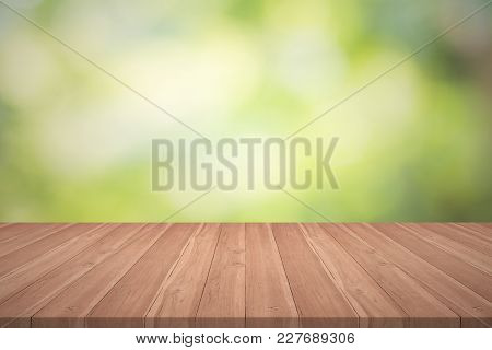 Wood Table Top On Nature Green Blurred Background For Montage Your Products