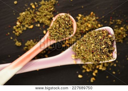 Zaatar spice mix - traditional Middle Eastern blend made with thyme, sesame seeds, salt, sumac, oregano, cumin, fennel seeds and marjoram
