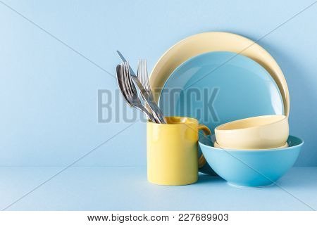 Crockery And Cutlery On A Blue Pastel Background