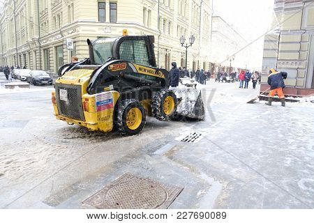 Moscow, Russia - February 18 2017: Mini Tractor Cleaning The Street In Moscow City Center From The S