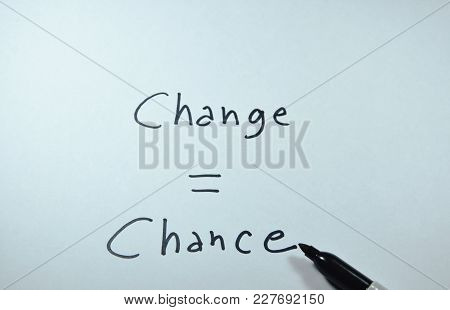 Pen Writing Change Equal Chance Word On White Paper