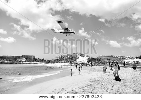 St Maarten, Netherlands - February 13, 2016: International Jet Flight Lands Over Maho Beach At Princ