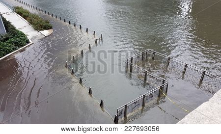 Pedestrian Walkway River Walk Along The Chicago River Flooded And Inundated With Water From A Recent
