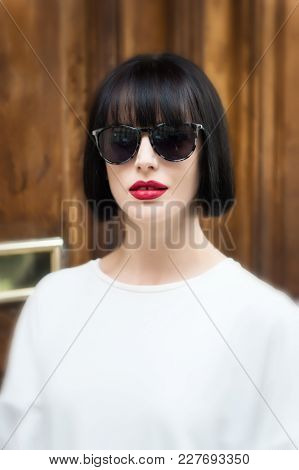 Look And Retro Style. Beauty And Vintage Fashion. Girl In Fashionable Glasses And Shirt. Fashion Mod