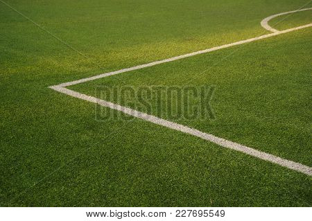 Green Glass Texture Of Football Or Soccer Field With White Corner Line Background